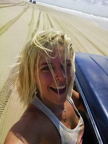 a girl driving off road in Fraser Island, Australia