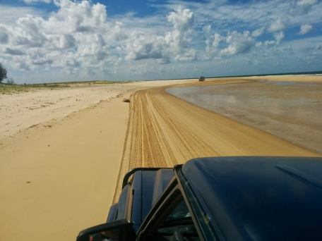 A sandy beach that people 4WD on in Fraser Island, Australia