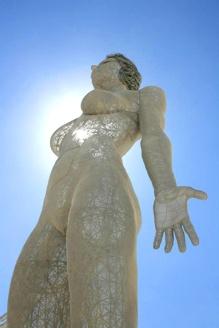 Evolution art sculpture at burning man, a 48 foot tall breathing metal woman