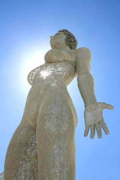 Evolution art sculpture at burning man, a 48 foot tall breathing metal woman