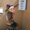 Girl sitting in a reflection booth at Burning Man