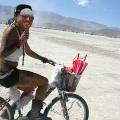girl riding bike at burning man 2015