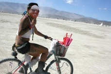 girl riding bike at burning man 2015
