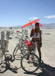 girl with red umbrella at burning man