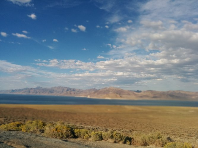 View out the car window of the Nevada desert and Mountain ranges