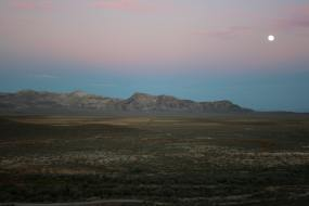 Full moon rises above the Nevada mountains