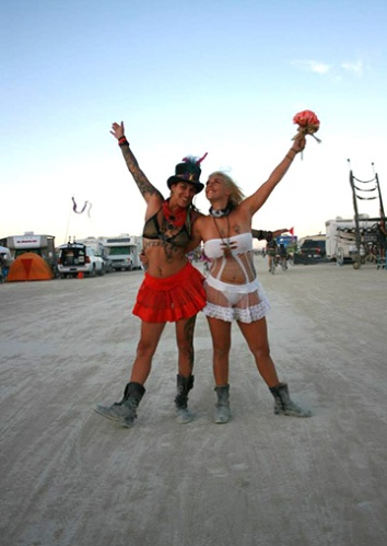 Two brides celebrate on the playa after being married at Burning Man