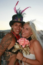 two brides pose for wedding portraits after their burning man wedding