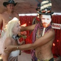 A burner bride is given away at the alter of her Burning Man wedding