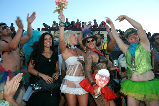 A newly wed couple celebrates at Distrikt theme camp at Burning Man