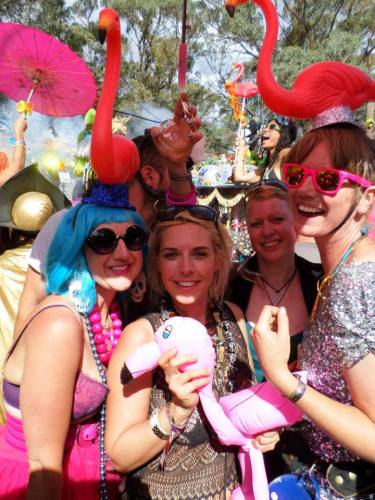 girls with flamingos at festival