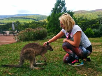 girl petting kangaroo