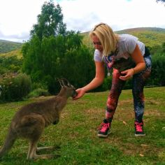 girl petting kangaroo
